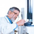 Senior male researcher carrying out scientific research in a lab — Stock Photo #11302893