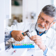 Senior male researcher carrying out scientific research in a lab — Stock Photo #11302959