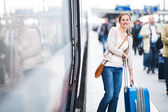 Just arrived: young woman at an airport having just left the air — Stock Photo