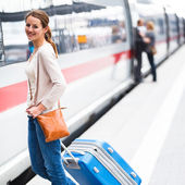 Just arrived: young woman at an airport having just left the air — Stockfoto