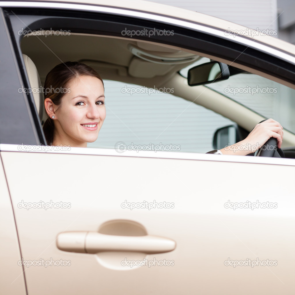 Pretty young woman driving her new car — Stock Photo #11302950