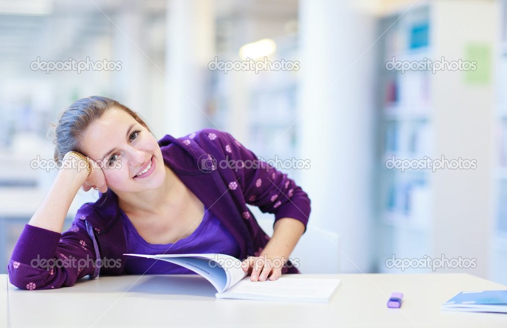 Female college student in a library (shallow DOF; color toned image) — Stock Photo #11303023