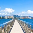 Walkway along the coast with Hong Kong skyline - Stock Photo