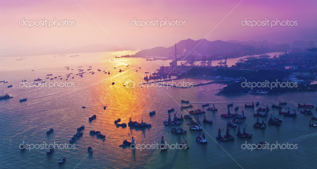 Sunset coast in container terminal and bridges — Stock Photo #10964856