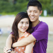 Asian couple smiling — Stock Photo