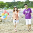 Happy asicouple at beach — Stock Photo #11655405
