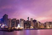 Coucher de soleil à hong kong avec fond de bâtiments de bureau — Photo