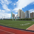 Running track and stadium in residential area - Stock Photo