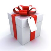 Gift box with a price tag — Stock Photo
