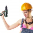 Sexy craftswoman in overalls — Stock Photo