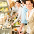 Business woman take cafeteria lunch smiling - Stock Photo