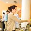 Young business colleagues select canteen lunch — Stock Photo #10745062