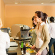 Royalty-Free Stock Photo: Cafeteria pay at cashier women in queue