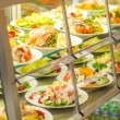Cafeteriself service display food fresh salad — Stock Photo #10745204