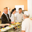 Business colleagues cook serve lunch canteen food — Stock Photo