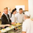 Business colleagues cook serve lunch canteen food — Foto de stock #10745234