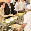 Постер, плакат: Business colleagues cook serve lunch canteen food