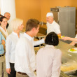 Office womin canteen lunch-lady serve meals — Stock Photo #10745306