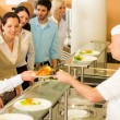 Office colleagues in canteen cook serve meals — Stock Photo #10745328
