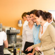 Paying at cafeteriwomcashier serve woman — Foto de stock #10745342