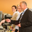 Cafeteria business man pay by credit card cashier - Foto de Stock