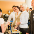 Cafeteria cashier woman check guest list - Stock Photo