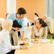 Lunch break office colleagues eat salad cafeteria — Stock Photo