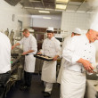 Stock Photo: Professional kitchen busy team cooks and chef