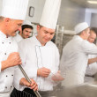 Two male cook work in professional kitchen — Stock Photo