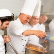 Two professional chefs cooking in kitchen — Stock Photo