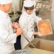 Two professional chefs cooking in kitchen — Stock Photo #10745481