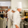 Foto Stock: Group of cooks in professional kitchen