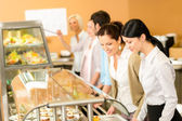Cafeteria lunch two office woman choose food — Stock Photo