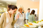 Young business colleagues select canteen lunch — Stock Photo
