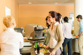Cafeteria pay at cashier women in queue — Stock Photo