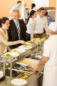 Business colleagues cook serve lunch canteen food — Foto de Stock