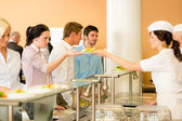 Office woman in canteen lunch-lady serve meals — Stock Photo
