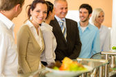 Business colleagues waiting for canteen lunch — Stock Photo