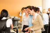 Paying at cafeteria woman cashier serve woman — Stock Photo