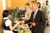 Cafeteria business man pay by credit card cashier — Stock Photo