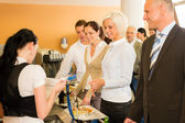 Cafeteria cashier woman check guest list — Stock Photo