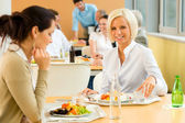 Cafeteria lunch young business woman eat salad — Stock Photo