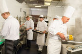 Professional kitchen busy team cooks and chef — Stock Photo