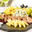 Catering buffet cheese plate with pate - Stock Photo