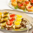 Appetizers mini desserts on catering buffet plate — Stock Photo #10887426