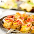 Catering canapes tray food details appetizers — Stock Photo #10887499
