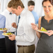 Smiling business woman during company lunch buffet — Stock Photo #10888048