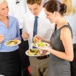 Business colleagues eat buffet appetizers — Stock Photo #10888062