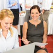 Business woman work during company buffet — Stock Photo