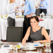 Business woman work during catering buffet — ストック写真